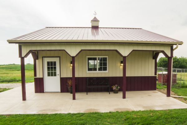 Sample pole barn with a walk entry and poured concrete patio.